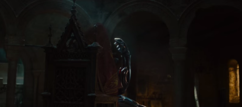 He's wearing a red cloak. Trust me.